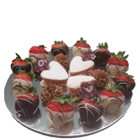 Petit four plate with chocolate dipped strawberries