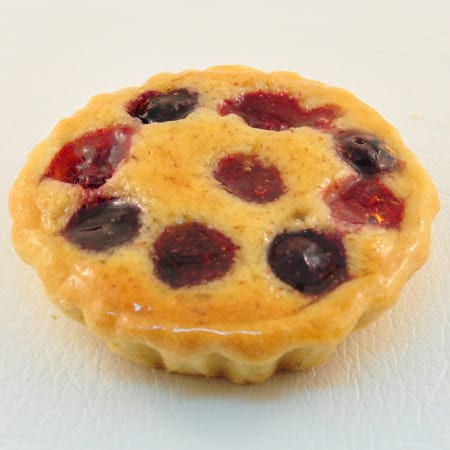 Individual berry and almond flan